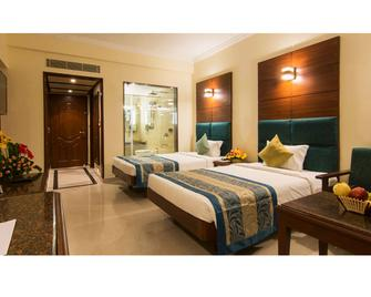 Shenbaga Hotel & Convention Centre - Пондишери - Спальня