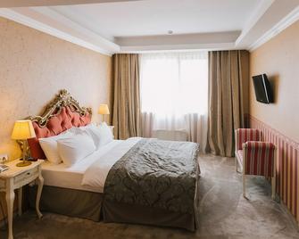 Roman Plaza - Roman - Bedroom