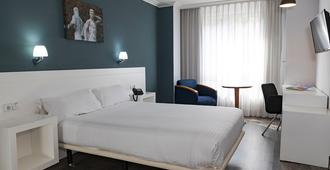 Gran Hotel Regente - אוביידו - חדר שינה
