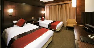 โรงแรมวิง อินเตอร์เนชั่นแนล พรีเมียม โตเกียว โยสึยะ - โตเกียว - ห้องนอน