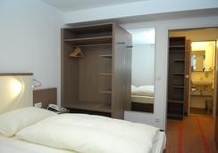 Landhotel Martinshof - München - Makuuhuone