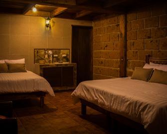 Hotel Real Nirvana - Tecozautla - Schlafzimmer