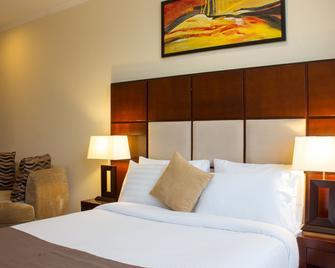Seashells Millennium Hotel - Daressalam - Schlafzimmer