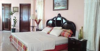 Mansion Giahn Bed & Breakfast - Cancún - Schlafzimmer