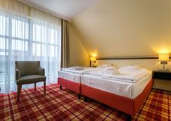 百慕森 - 酒店•高爾夫•水療 - 本茲 - 巴爾姆 - 臥室
