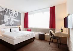 Vienna House Easy München - Мюнхен - Спальня