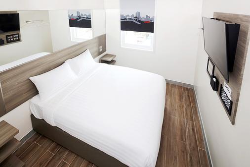 Red Planet Aurora Boulevard - Quezon City - Phòng ngủ
