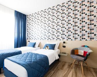 أبارت هوتل إيزولا - ميلان - غرفة نوم