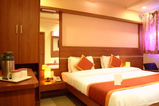 Hotel Sunset Inn Mount Abu with Swimming Pool - Mount Abu - Bedroom