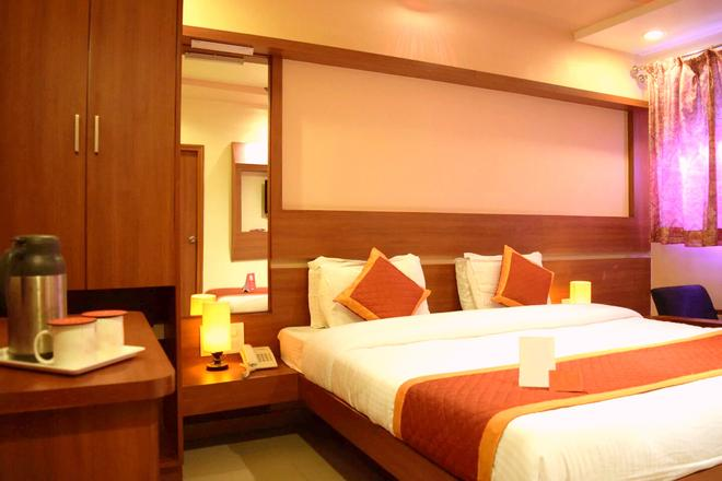 Hotel Sunset Inn Mount Abu with Swimming Pool - Mount Abu - Schlafzimmer