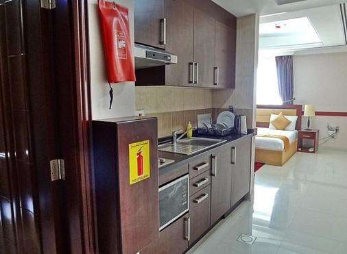 Hala Inn Hotel Apartments - Ajman - Kitchen