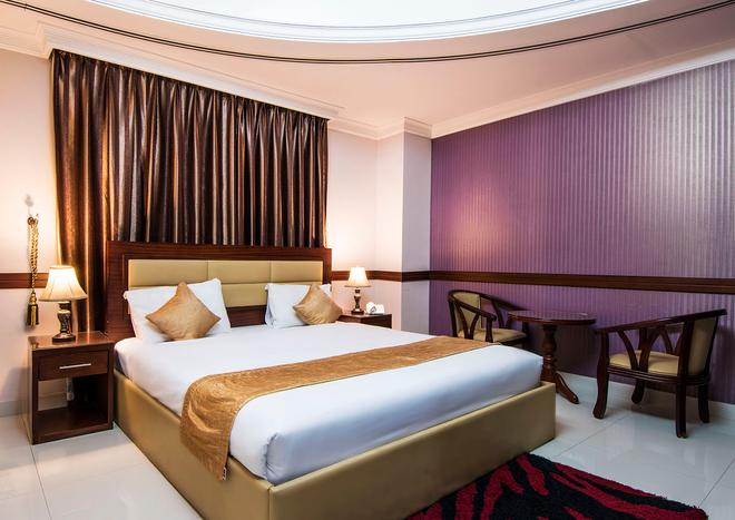 Hala Inn Hotel Apartments - Ajman - Bedroom
