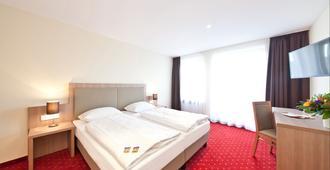 Novum Hotel Madison Düsseldorf Hauptbahnhof - Düsseldorf - Kamar Tidur