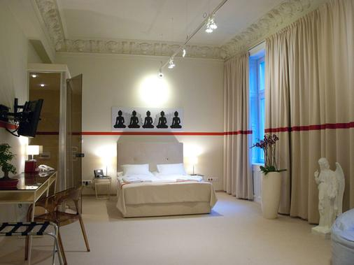 Home Hotel - Krakau - Schlafzimmer