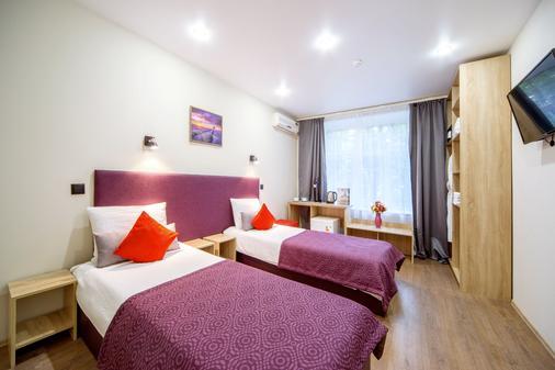 Hotel Piter on Dobrolyubova - Saint Petersburg - Bedroom