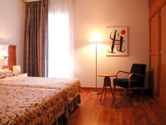 Extremadura Hotel - Cáceres - Schlafzimmer