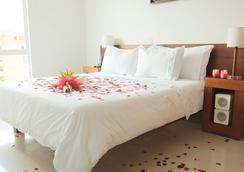 格拉納達摩根娜塞爾科蒂爾套房酒店 - 麥德林 - 麥德林 - 臥室