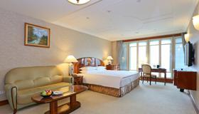 エバーグリーン ローレル ホテル - 台北市 - 寝室