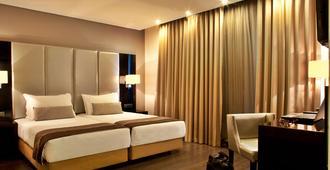 تي يو آر أي إم إيه في ليبرداد هوتل - لشبونة - غرفة نوم