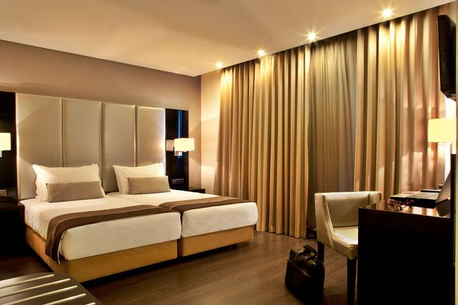 Turim Av Liberdade Hotel - Лиссабон - Спальня