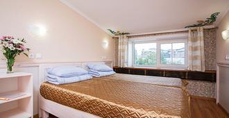 Hotel on Rimskogo-Korsakova - Saint Petersburg - Bedroom