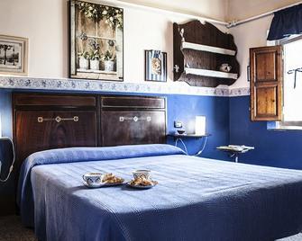 Al Piano di Sopra - Massarosa - Schlafzimmer