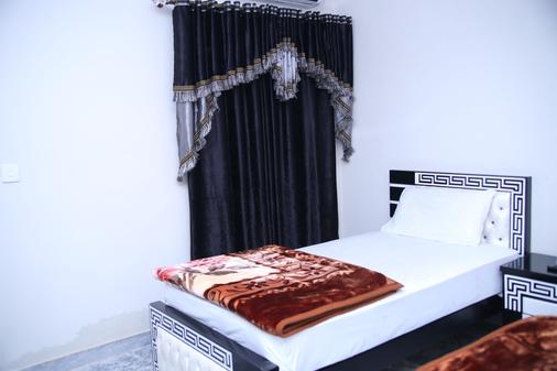 Family Hotel Lahore - Lahore - Bedroom