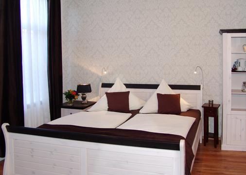 Hotel Garni Landhaus Uttum - Krummhörn - Bedroom