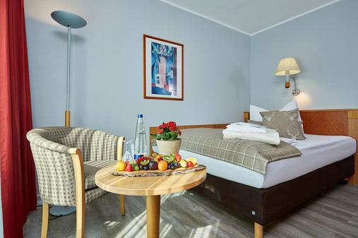 Hotel Königshof - Γκάρμις-Παρτενκίρχεν - Κρεβατοκάμαρα