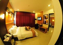 Swarna Dwipa Hotel - Palembang - Schlafzimmer