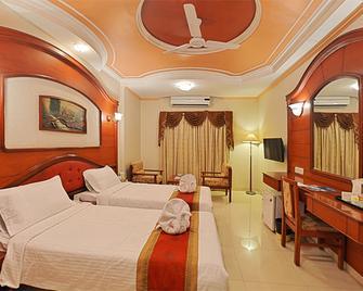 Hotel Gnanam - Tanjavur - Schlafzimmer
