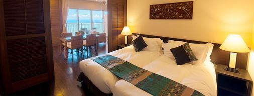 Kafuu Resort Fuchaku Condo Hotel - Onna - Schlafzimmer