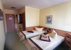 Acron Hotel Quedlinburg - Quedlinburg - Bedroom