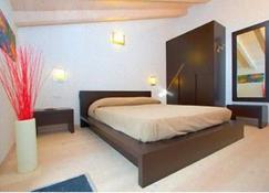 Hotel Isola Verde - Nago - Makuuhuone
