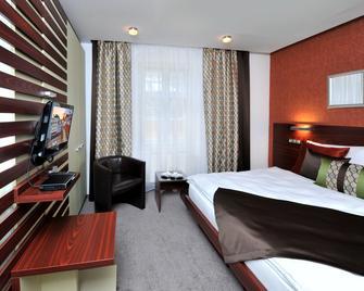 호텔 미칼스카 브라나 - 브라티슬라바 - 침실