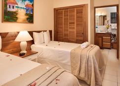 SunBreeze Suites - San Pedro Town - Schlafzimmer