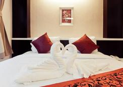 Excella Hotel - Ubon Ratchathani - Phòng ngủ
