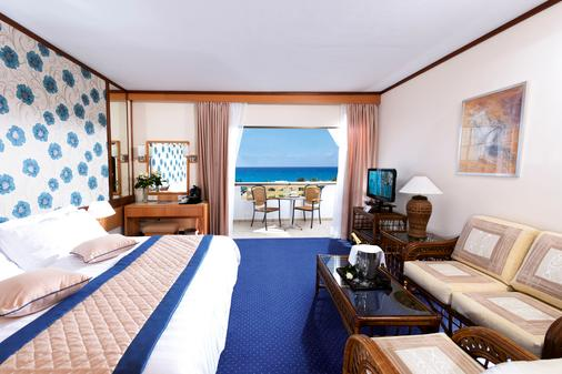 Constantinou Bros Athena Royal Beach Hotel - Paphos - Phòng ngủ