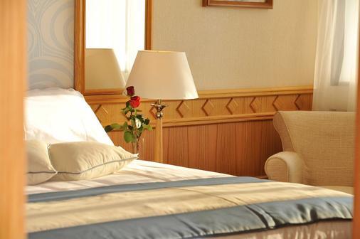 Constantinou Bros Asimina Suites Hotel - Пафос - Спальня