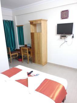 A V Residency - Ernakulam - Makuuhuone