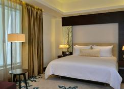 DoubleTree by Hilton Gurugram Baani Square - Gurugram - Slaapkamer