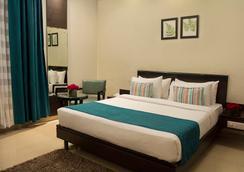 Rockland Hotel Panchsheel Enclave - New Delhi - Bedroom