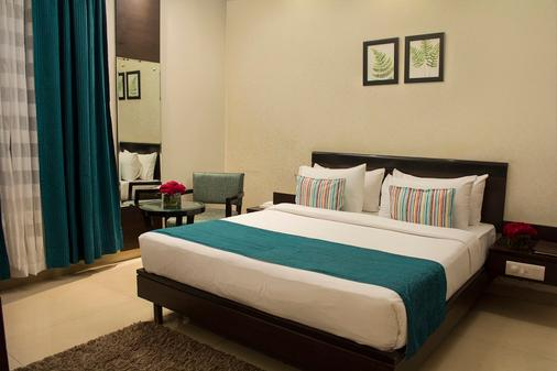 Rockland Hotel Panchsheel Enclave - New Delhi - Makuuhuone