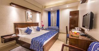 Rockland Hotel - C R Park - Neu-Delhi - Schlafzimmer