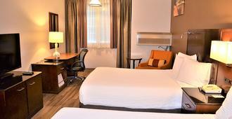The Ashley Inn & Suites - לינקולן סיטי - חדר שינה