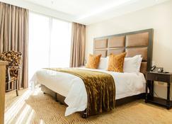 Mpilo Boutique Hotel - Масеру - Спальня