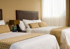 Rincón Del Valle Hotel & Suites - San José - Phòng ngủ