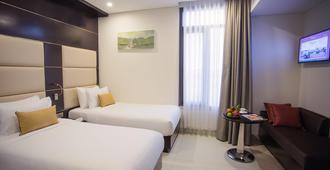 峴港海灘假日度假飯店 - 峴港 - 臥室