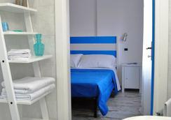 Metropolis Rooms & Services - Fiumicino - Makuuhuone