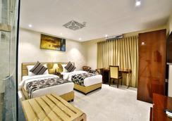 Hotel King's Heritage - Sūrat - Bedroom